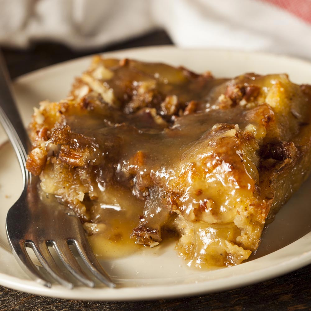 Cinnamon Raisin Bread Pudding with Honey Whiskey Sauce